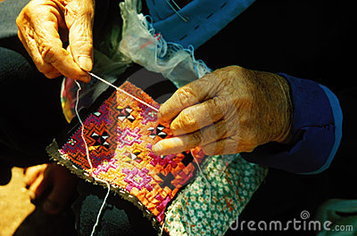 Old hands sewing