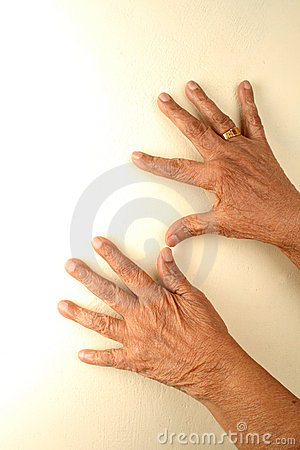 Old hands on walls