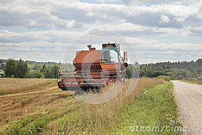 Old Harvester On The Field Royalty Free Stock Photo - Image: 26117965