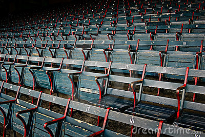 old historic wood stadium seats at fenway park stock