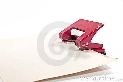 Old hole punch with old paper