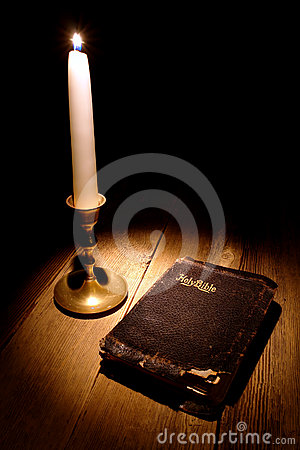 Old Holy Bible Antique Book in Soft Candle Light