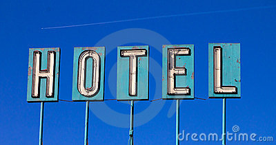 Old Hotel Sign And Airplane Isolated On Blue
