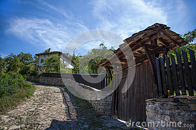 Old House And Gate.