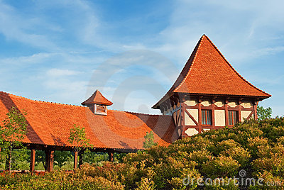 Old house with orange tiled roof in a park