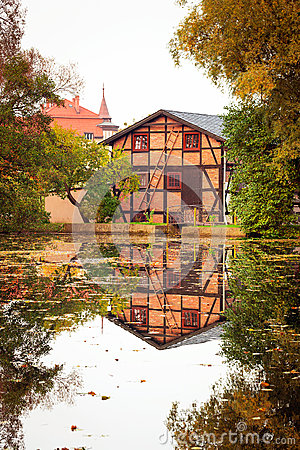 Old house with reflection in the pond