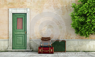 Old house with vintage suitcases