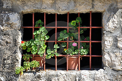 Old house window with bars