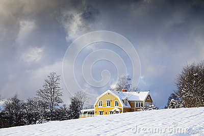 Old house in a winter landscape