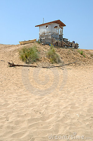 Old hut in deserted beach