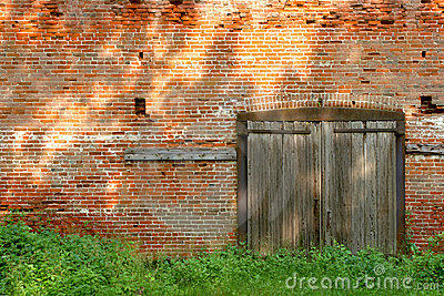 Old Industrial Brick Building with Wood Doors