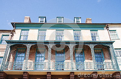 Old Iron Balconies on Yellow and Green Building