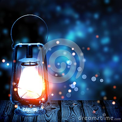 Free Old Kerosene Lamp Shining In The Dark Blue Blur In The Background Stock Photography - 63287222