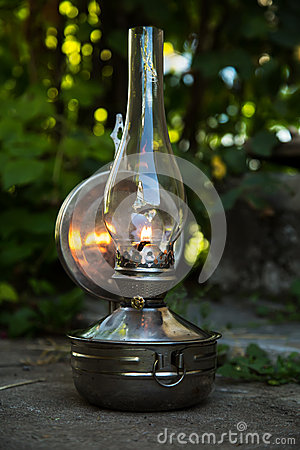Free Old Kerosene Lamp Stands On The Ground, Outdoors Royalty Free Stock Photos - 56741788