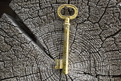 Old key of gold colour.