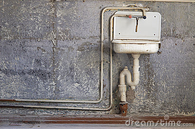 Old kitchen washer on background
