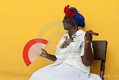 Old lady with a fine cigar in Havana Editorial Image