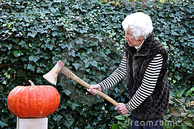 Old lady modelling a pumpkin