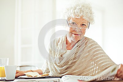 Old Lady with the Morning Newspaper