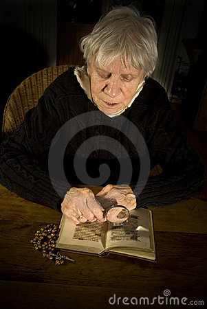 Old lady reading in bible
