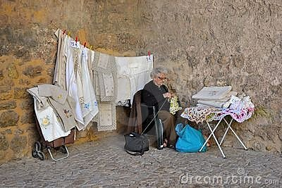 Old lady selling laces Editorial Photo