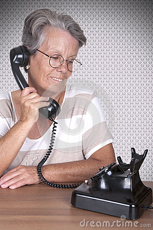 Old lady talking on old phone