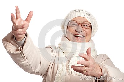 Old lady at winter with open arms smiling