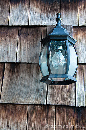 Old Lamp on a Wooden Wall
