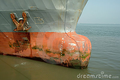 Old large rusty ship moored
