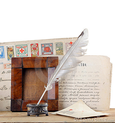 Old letters and a quill pen