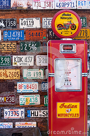 Old license plates and gas pump Editorial Stock Image