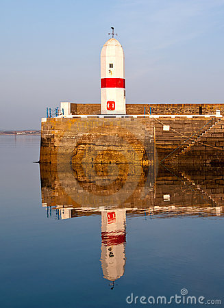 Free Old Lighthouse With Sea Water Reflection Royalty Free Stock Image - 19666406