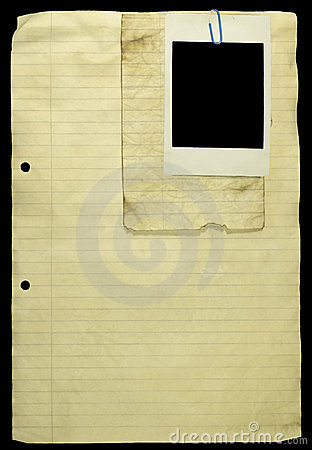 Old Lined paper with paper clip and a polaroid.