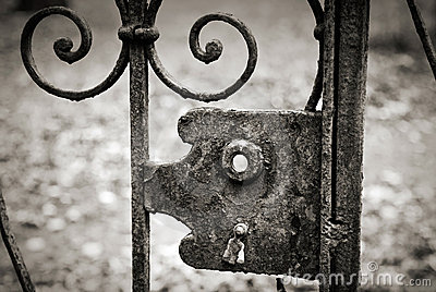 Old lock on the metal fence