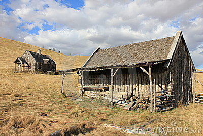 Old Log Barn and House with Sky