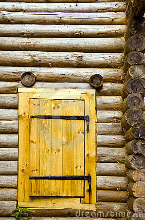 Old log house background new wooden door of board