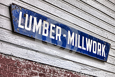 Old Lumber Millwork Enamel Sign on Building Wall