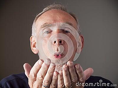 video blowing an older man