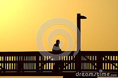 Old man on boardwalk