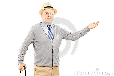 Old man with cane gesturing with hand