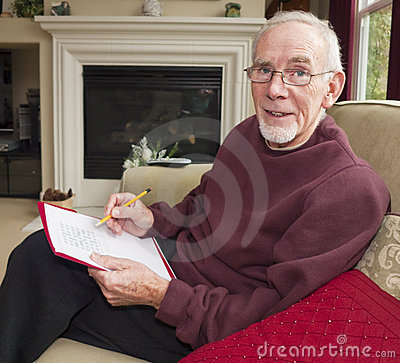 Old man doing word puzzle