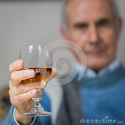 Old man making a toast