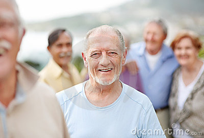 old man enjoying outdoors with people