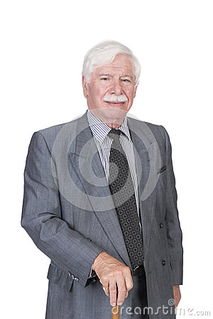 Old man in grey suit and walking stick Stock Photo