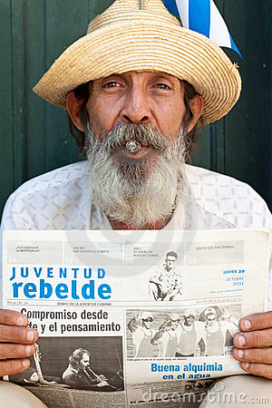 Old man in Havana  with a cuban newspaper Editorial Stock Photo