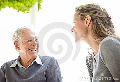 An old man and his daughter enjoying themselves