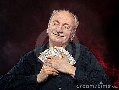 Old man holding dollar bills
