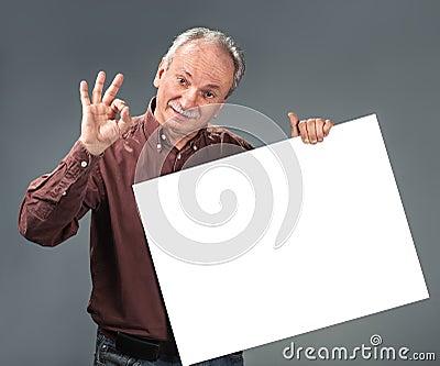 Old man holding empty billboard