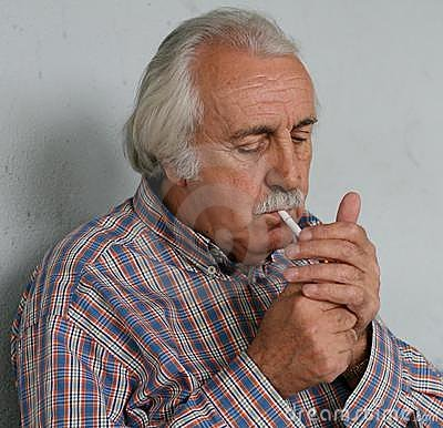Old Man Lightening A Cigarette