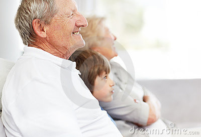 Old man looking away with his wife and grandson